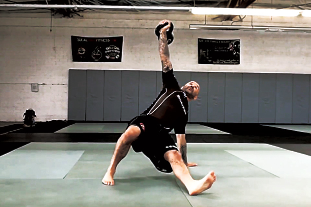 Joey Alvarado performing the Kettlebell Turkish Get Up Exercise.