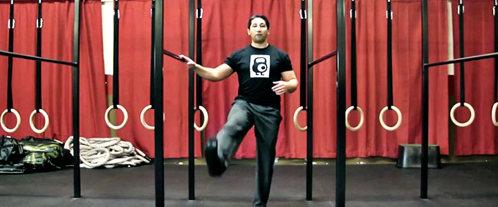 John Wolf performs the forward leg circle to increase hip mobility,hip strength and alleviate back pain
