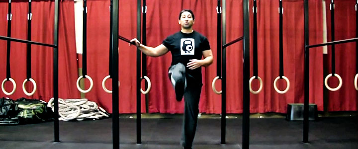John Wolf performs the forward leg swing to increase hip mobility,hip strength and alleviate back pain