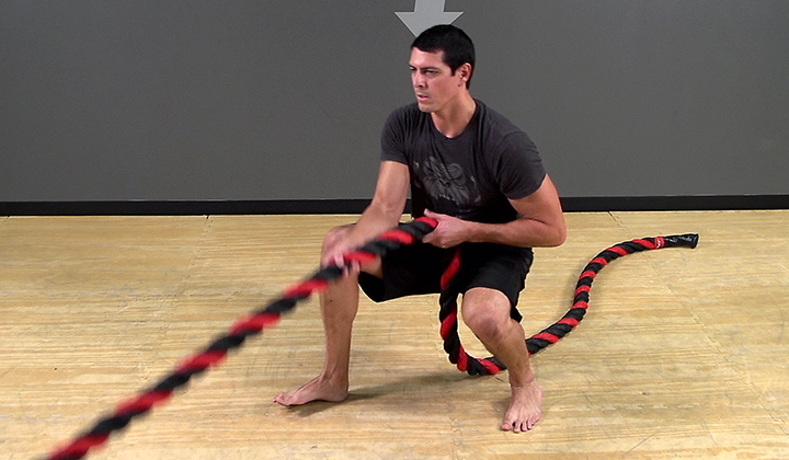 Battle Rope Exercise: Anchored Squat Stance Traveling Row