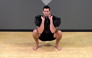 Sandbag Exercise: Zercher Squat