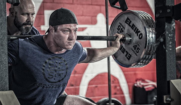 Onnit's Casey Williams practicing the Back Squat