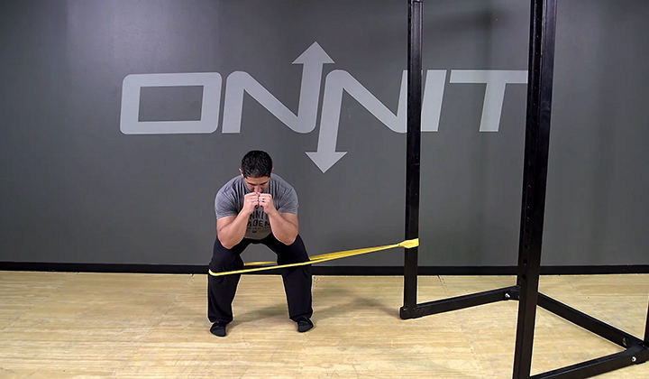 Lateral Band Resisted Squat Hold Bodyweight Exercise