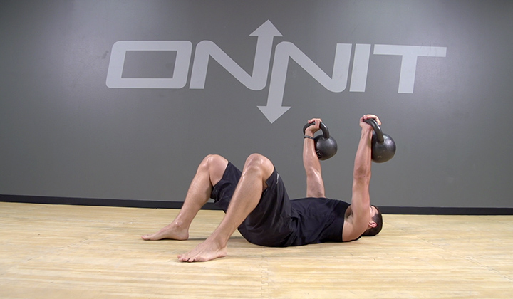 The Double Floor Press Combines A Shoulder And Chest Workout Along With  Your Core. Using Kettlebells For The Exercise Provides A Unique Challenge.