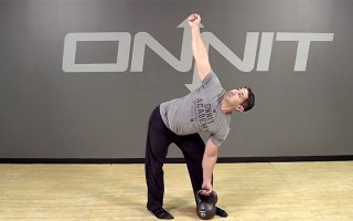 Windmill from ground kettlebell exercise