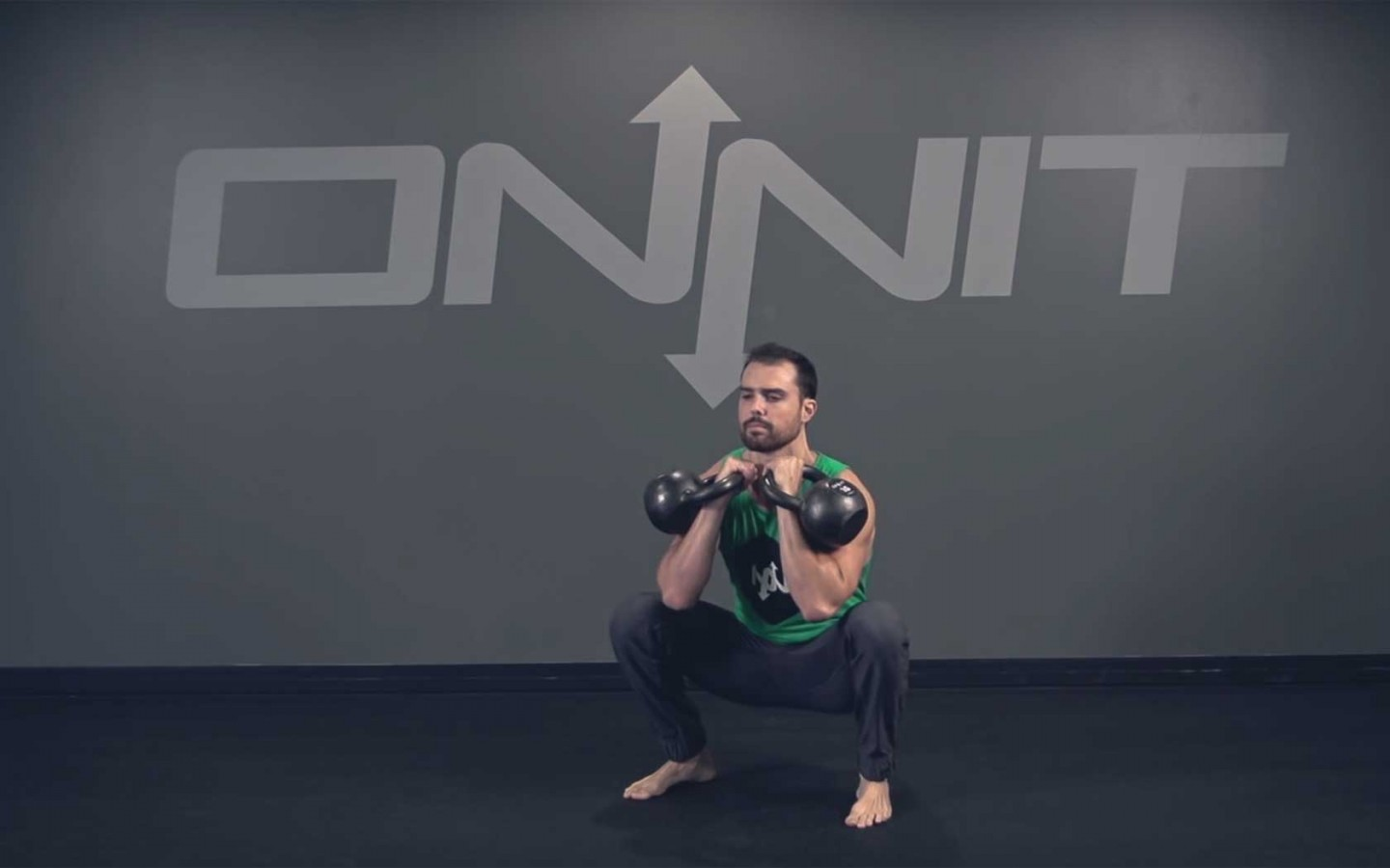 Double Kettlebell Front Squat Exercise