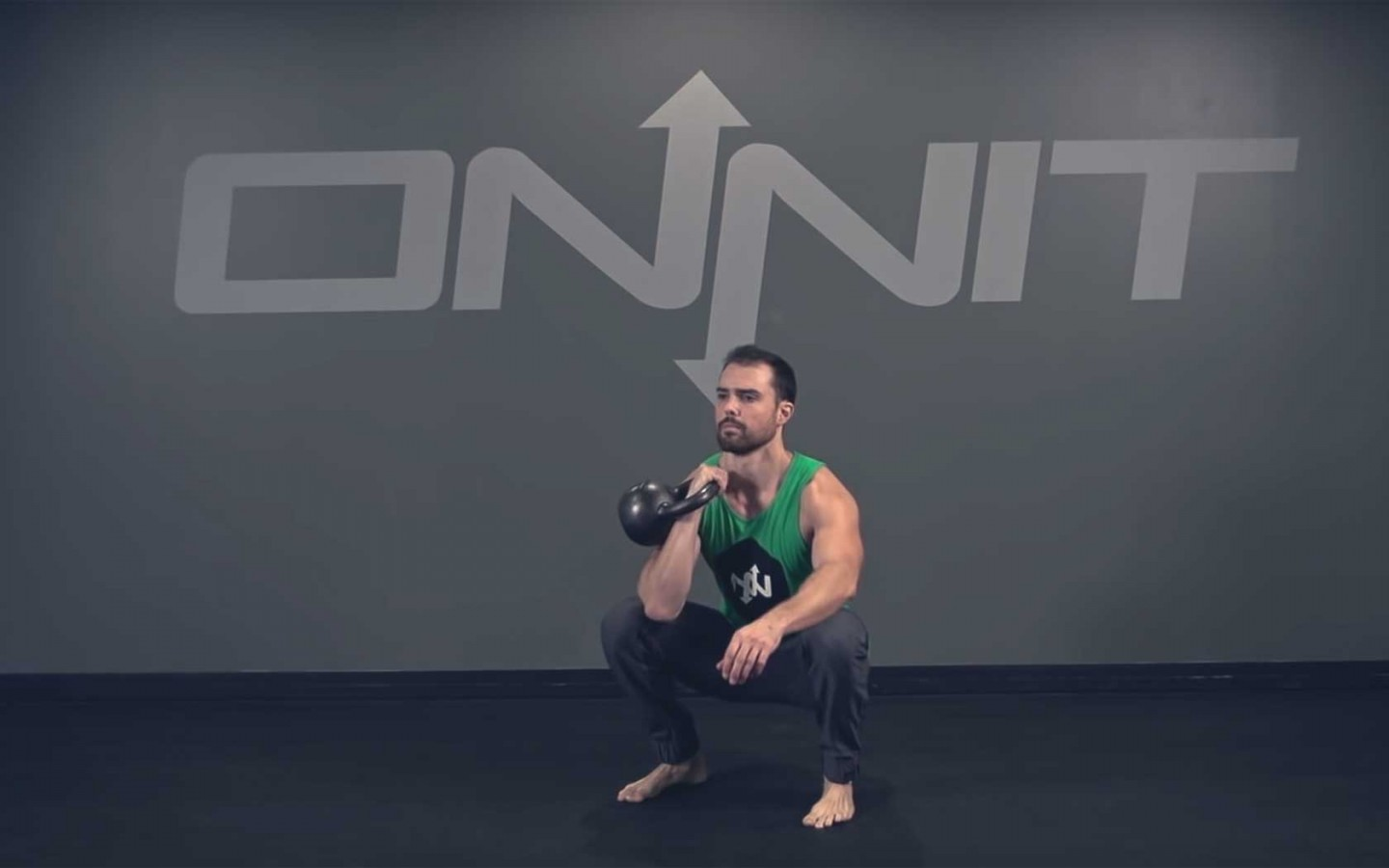 One Arm Kettlebell Front Squat Exercise
