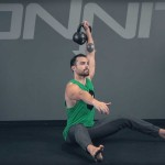 Seated One Arm Kettlebell Press Exercise