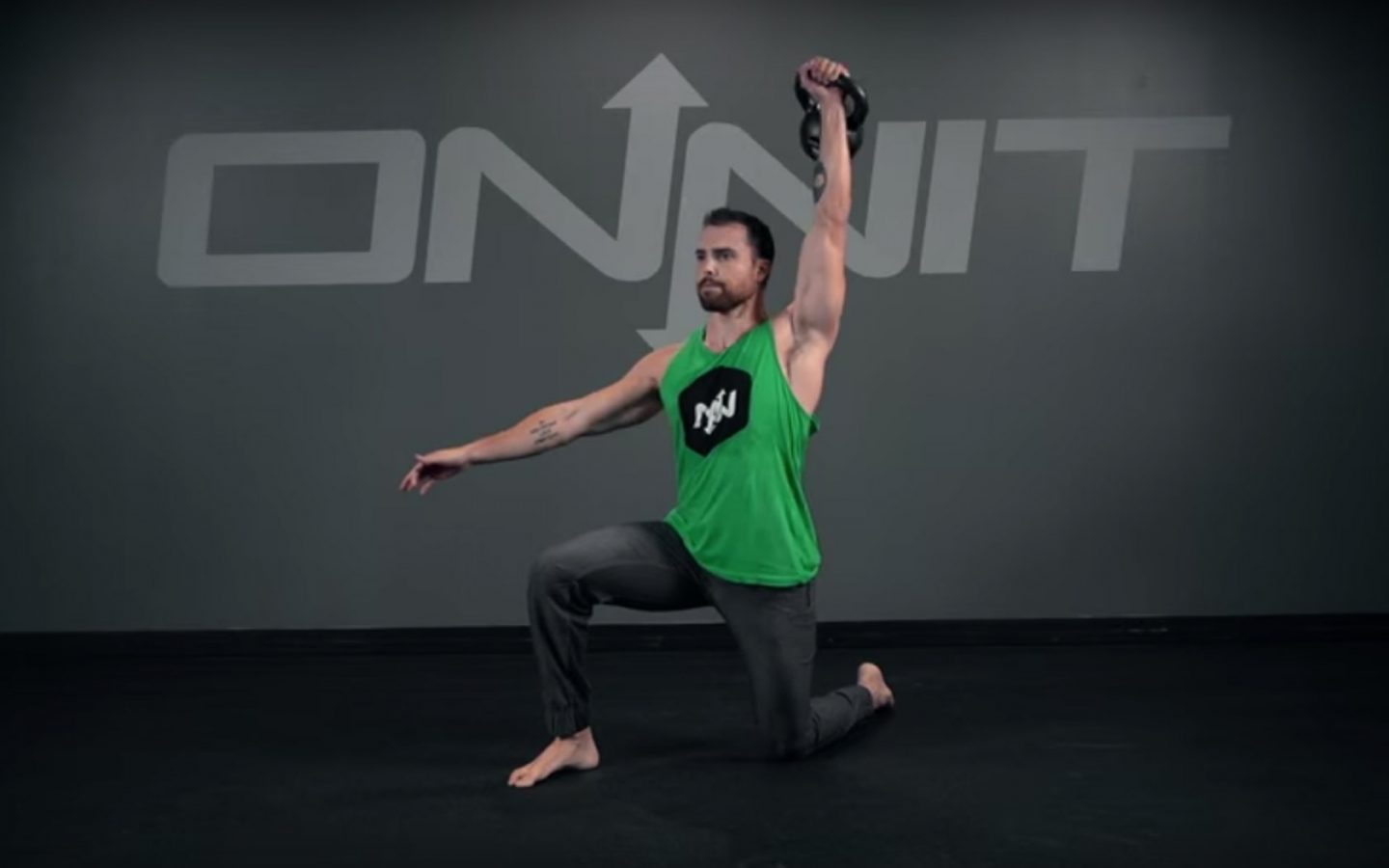 Half-Kneeling One Arm Kettlebell Snatch Exercise